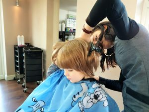 boy having a haircut