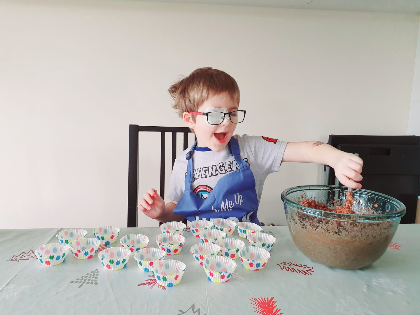 boy making chocolate cakes